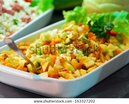 mixed vegetables dish with green salad in restaurant buffet - stock photo