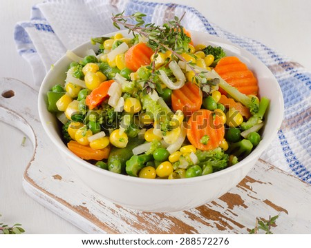 Mixed vegetables in  white bowl. Selective focus - stock photo