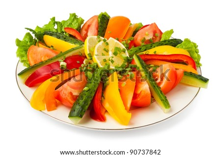 mixed vegetables on a plate against white background