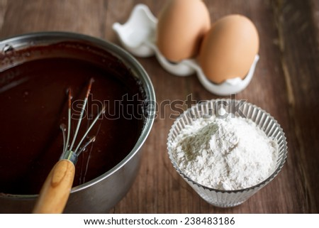 mixed yolk eggs, flour and sugar prepare for baking cake or bake - stock photo