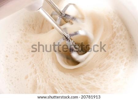 Mixing a dough - stock photo