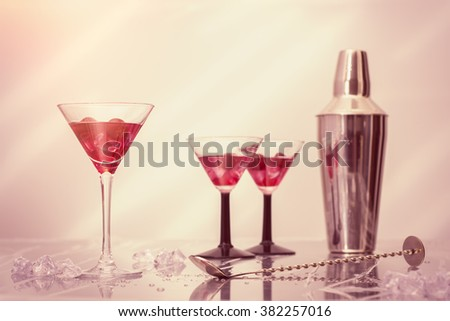 Mixing cocktails in Art Deco glasses over crushed ice - stock photo