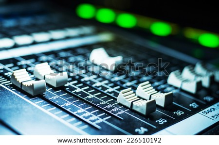 Mixing desk faders , for music and sound.  A little of DOF.  - stock photo
