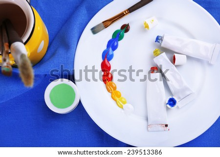 Mixing paints, close-up - stock photo