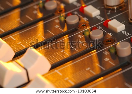 mixing soundboard in golden light - stock photo