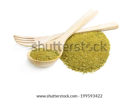 Mixture of dried ground spices for pesto in a wooden spoon with wooden fork - stock photo