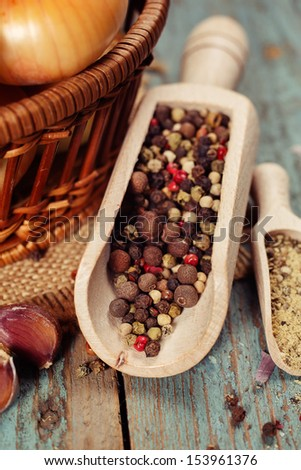 Mixture of hot peppers spilling from small wooden scoop. Macro with shallow dof. - stock photo