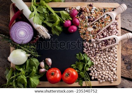 mixture of ingredients for preparing a soup on a blackboard - stock photo