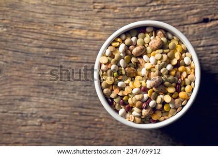 mixture of legumes in ceramic bowl - stock photo