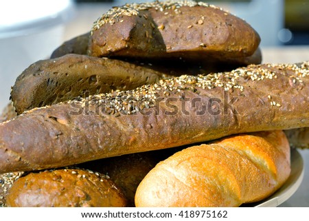 Mixture of loaves of white black and brown colour. - stock photo