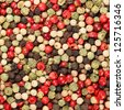 mixture of peppers hot pepper, red pepper, black pepper, white pepper, green pepper, background - stock photo