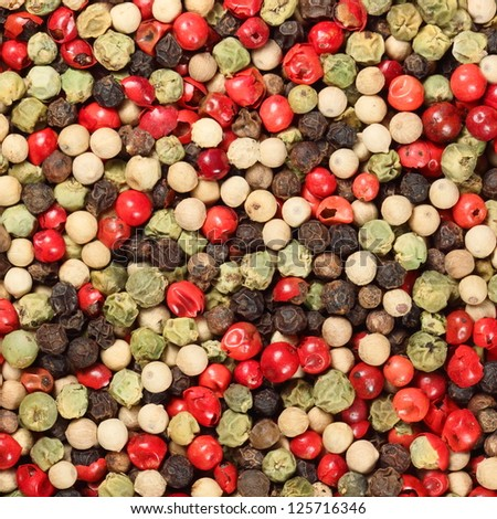mixture of peppers hot pepper, red pepper, black pepper, white pepper, green pepper, background - stock photo