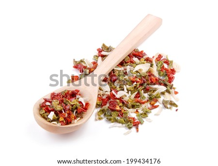 Mixture of spices in wooden spoon - stock photo