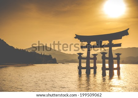 Miyajima, Famous big Shinto torii standing in the ocean in Hiroshima, Japan  - stock photo