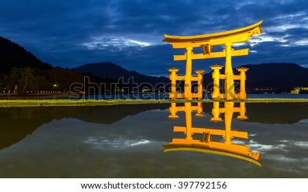 Miyajima, Hiroshima, famed floating torii gate Japan sunset - stock photo