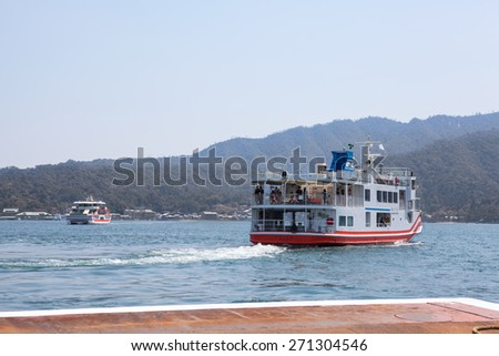 MIYAJIMAGUCHI, JAPAN - CIRCA APR, 2013: Ferry-boat of JR company starts cruise to the island of Miyajima (Itsukushima) in Hiroshima gulf. View from the Miyajimaguchi city pier - stock photo
