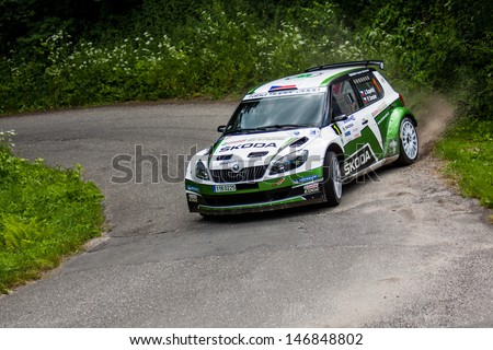 MLADA BOLESLAV, CZECH REP. - JULY 13 : Winners of Rally Bohemia Driver Kopecky J. and co driver Dresler P. in Skoda Fabia S2000 at speed stage no. 4 July 13, 2013 in Mlada Boleslav, Czech Republic.