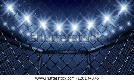 MMA cage and floodlights - stock photo