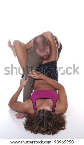 MMA Female Fighter applying a triangle choke submission - stock photo