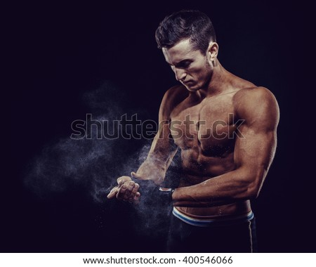 MMA Fighter Preparing Bandages For Training. Dark background - stock photo
