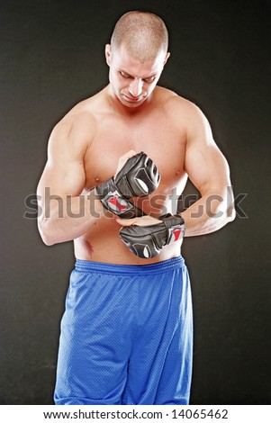 MMA Fighter with Gloves - stock photo
