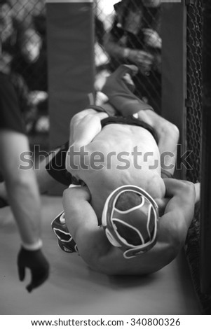 MMA fighters in clinch - stock photo
