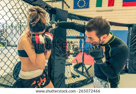 mma fighting training in the cage. concept about martial arts, sport, training, fitness and people - stock photo