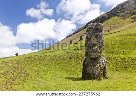 Moai in Rapa Nui National Park on the slopes of Rano Raruku volcano on Easter Island, Chile. - stock photo