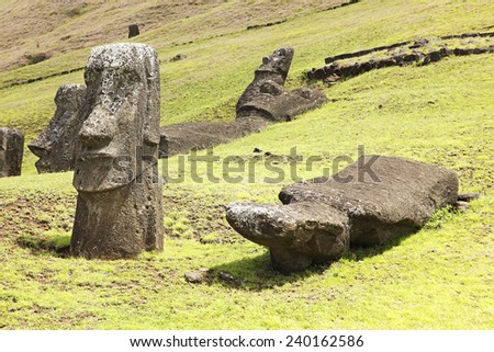 Moais in Rapa Nui National Park on the slopes of Rano Raruku volcano on Easter Island, Chile. - stock photo