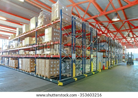 Mobile Aisle Racking System in Distribution Warehouse - stock photo