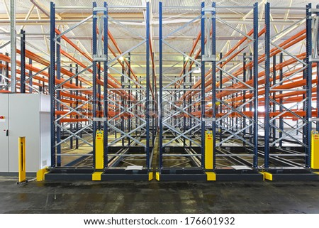 Mobile aisle roller racking system in warehouse - stock photo