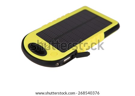mobile battery with a solar panel pack named as power bank with USB ports and a series of LED indicator for power volume in charging of personal mobile terminals and an LED bulb used for illumination - stock photo