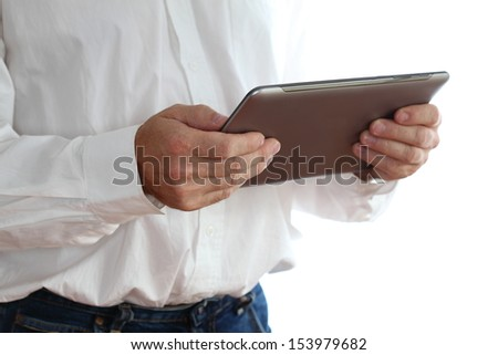 mobile computer in the hand of a business man
