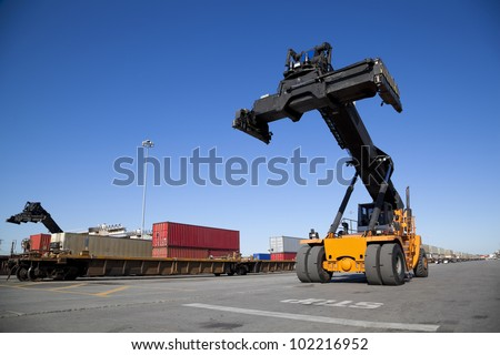 Mobile crane in train rail yard - stock photo