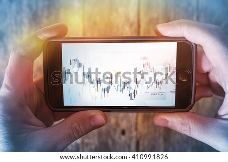 Mobile Forex Trader. Financial Trading Application Concept. Trader Watching Forex Indexes on His Smartphone. - stock photo