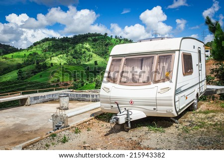 mobile home on a camping site at mountain - stock photo