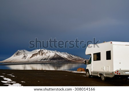 Mobile motor home RV campervan parked with beautiful landscape view, freedom vacation motorhome touring lifestyle - stock photo