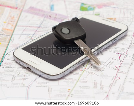 Mobile phone and key car on the map.travel concept. - stock photo