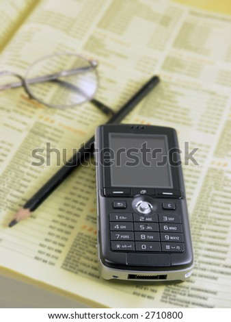 Mobile phone and phone directory - stock photo