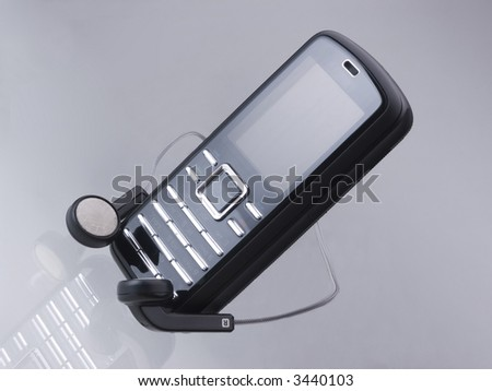 Mobile phone and the headphone - stock photo