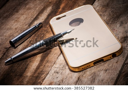 Mobile phone back cover on rustic white wooden background
