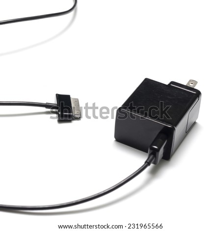 mobile phone charger on a white background - stock photo