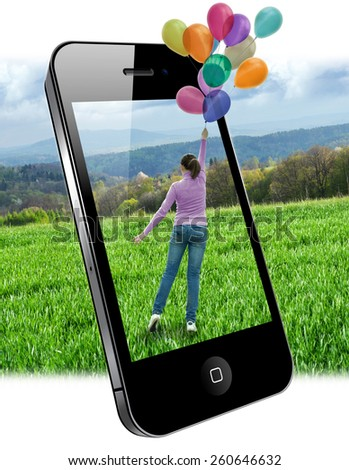 Mobile phone image on the screen - woman with balloons. - stock photo