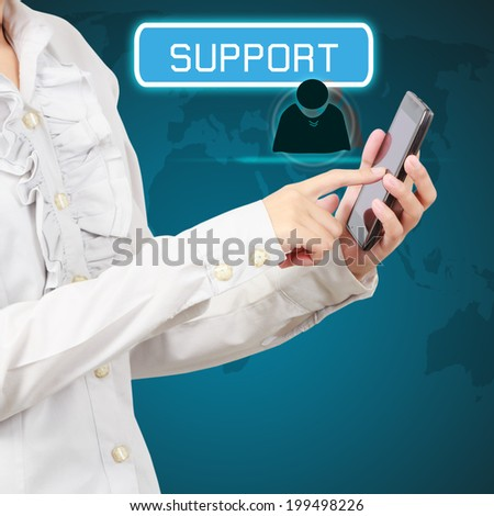 Mobile phone in a business woman hand showing concept support on virtual screen - stock photo