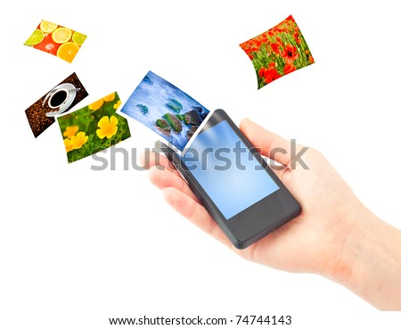 Mobile phone in hand. Isolated on white. - stock photo