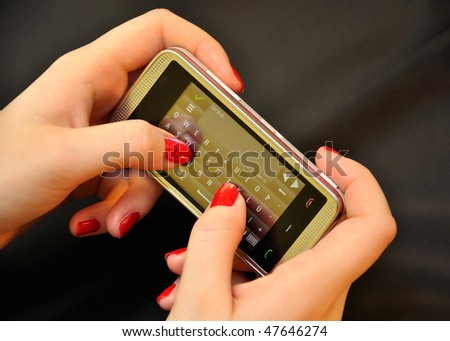 Mobile phone in the hands of women - stock photo