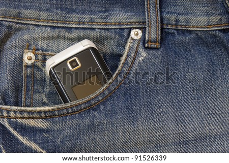 mobile phone in the pocket of jeans