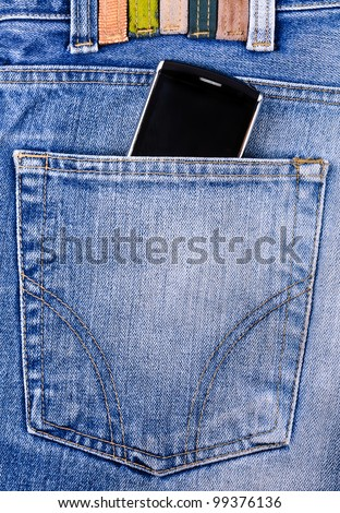 Mobile phone in your pocket jeans. Close-up Photos - stock photo