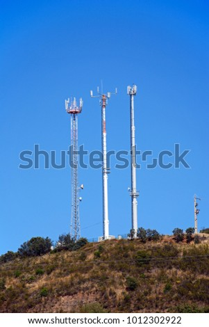 Mobile phone masts in the Monchique mountains near Arge, Algarve, Portugal, Europe.