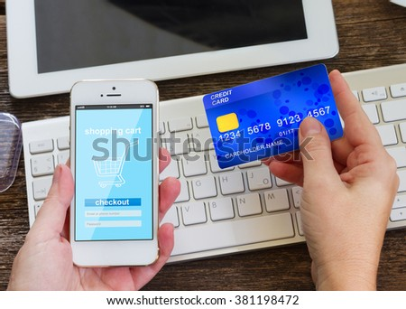 mobile phone shopping concept  - checking out payment in virtual shop on phone - stock photo